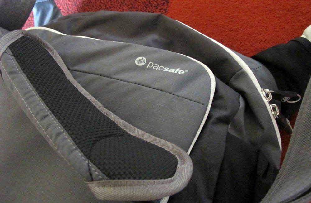 pacsafe-rubber-strap pacsafe shoulder bag