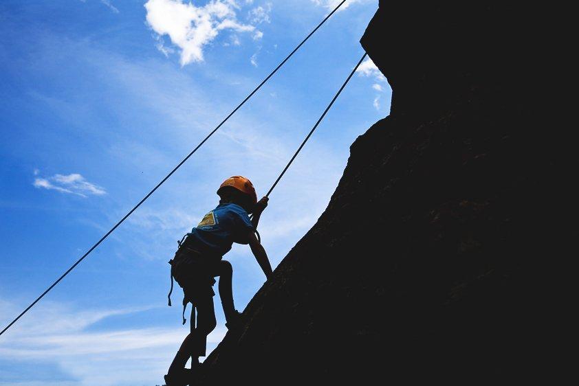 summer camp kid rock climbing
